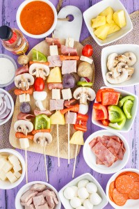 Skewers of Raw Pizza Kabobs, including potatoes, mushroom, cheese, pineapple and more